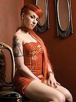 Red-haired Miss Conduct poses in latex