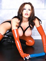 Christina in latex plays with her dildo