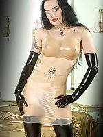 Latex model Morrigan plays with her vibrator
