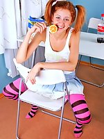 Redhead Elle in pink pantyhose stripping at home